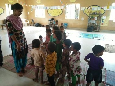 Children line up in the ECD center for an activity